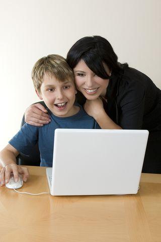 Bigstock-Adult-And-Child-Enjoying-Compu-1357782